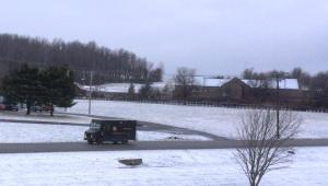 Snow UPS leaving farm
